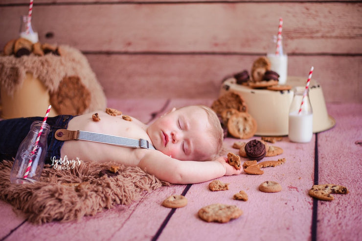 toddler kid with bookies sleeping during photo shoot