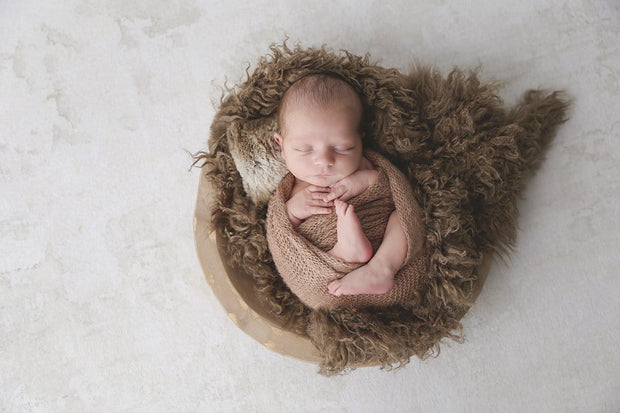 medium brown faux fur flokati newborn photography prop with baby boy in brown bowl