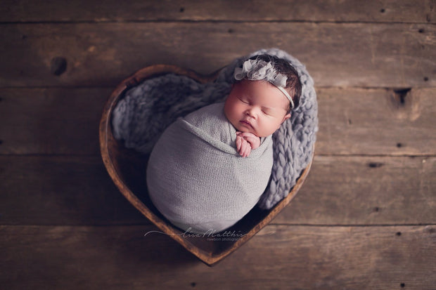 blue/gray/purple newborn stretch swaddling wrap with newborn baby girl in heart bowl photo prop