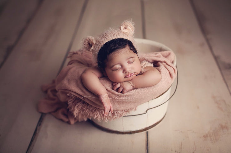 dusty pink faux fur and fuzzy swaddling wrap with baby girl in bucket photography props