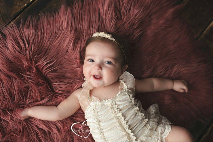 Baby Laying on Rose Pink Faux Fur Fabric