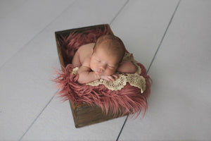 Newborn Girl in a Basket with Pink Faux Flokati Fur Photo Prop