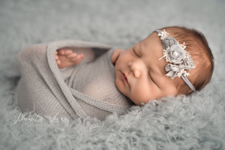 newborn in gray wrap photo prop