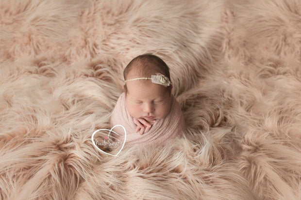 newborn on pale two toned sheepskin faux fur by custom photo props. Ships from Buffalo  New York