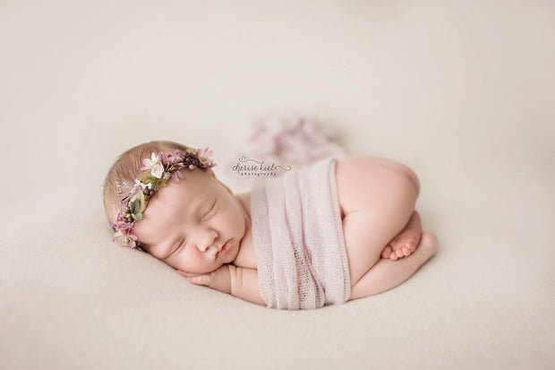 newborn wrapped in dream wrap photo prop