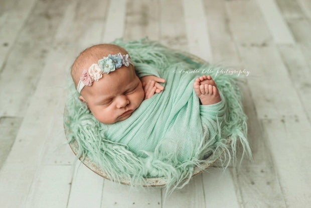 mint green wavy faux fur photo prop with baby girl in basket