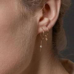 14k gold earrings with diamond.
