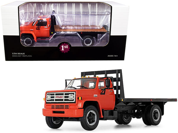 GMC 6500 Flatbed Truck Orange and Black 1/34 Diecast Model by First Gear