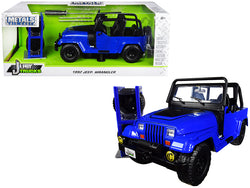 "1992 Jeep Wrangler Dark Blue with Extra Wheels ""Just Trucks"" Series 1/24 Diecast Model Car by Jada"