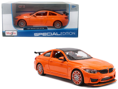 BMW M4 GTS Orange with Carbon Top and Orange Wheels 1/24 Diecast Model Car by Maisto