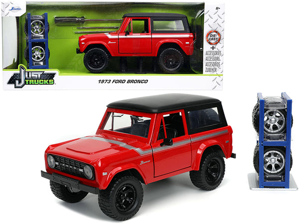 "1973 Ford Bronco Red with Black Top and Silver Stripe with Extra Wheels ""Just Trucks"" Series 1/24 Diecast Model by Jada"
