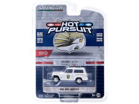 "1969 Jeep Jeepster ""Traffic Control"" ""Toledo Police"" (Ohio) White ""Hot Pursuit"" Series #35 1/64 Diecast Model Car by Greenlight"
