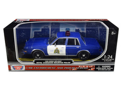 "1986 Dodge Diplomat ""Royal Canadian Mounted Police - RCMP"" Metallic Blue and White 1/24 Diecast Model Car by Motormax"
