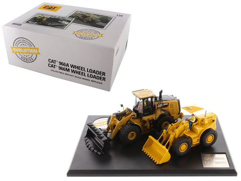 CAT Caterpillar 966A Wheel Loader (Circa 1960-1963) and CAT Caterpillar 966M Wheel Loader (Current) with Operators Evolution Series (2 Piece Set) 1/50 Diecast Models by Diecast Masters