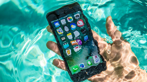 Non-waterproof iPhone submerged in water