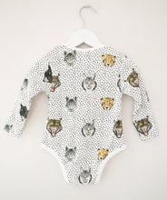 Made in super soft 100% cotton jersey rib and finished with pale gold trims, our hand-painted wild cats printed baby vest is the modern babywear essential item. Unisex, unique and utterly cool, this is a must buy for any millennial mother.