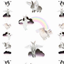 Flying Bunnies fabric is a children's dream bedroom or nursery scheme; fluffy bunny rabbits, soft sugary rainbows, and ombre watercolour clouds.