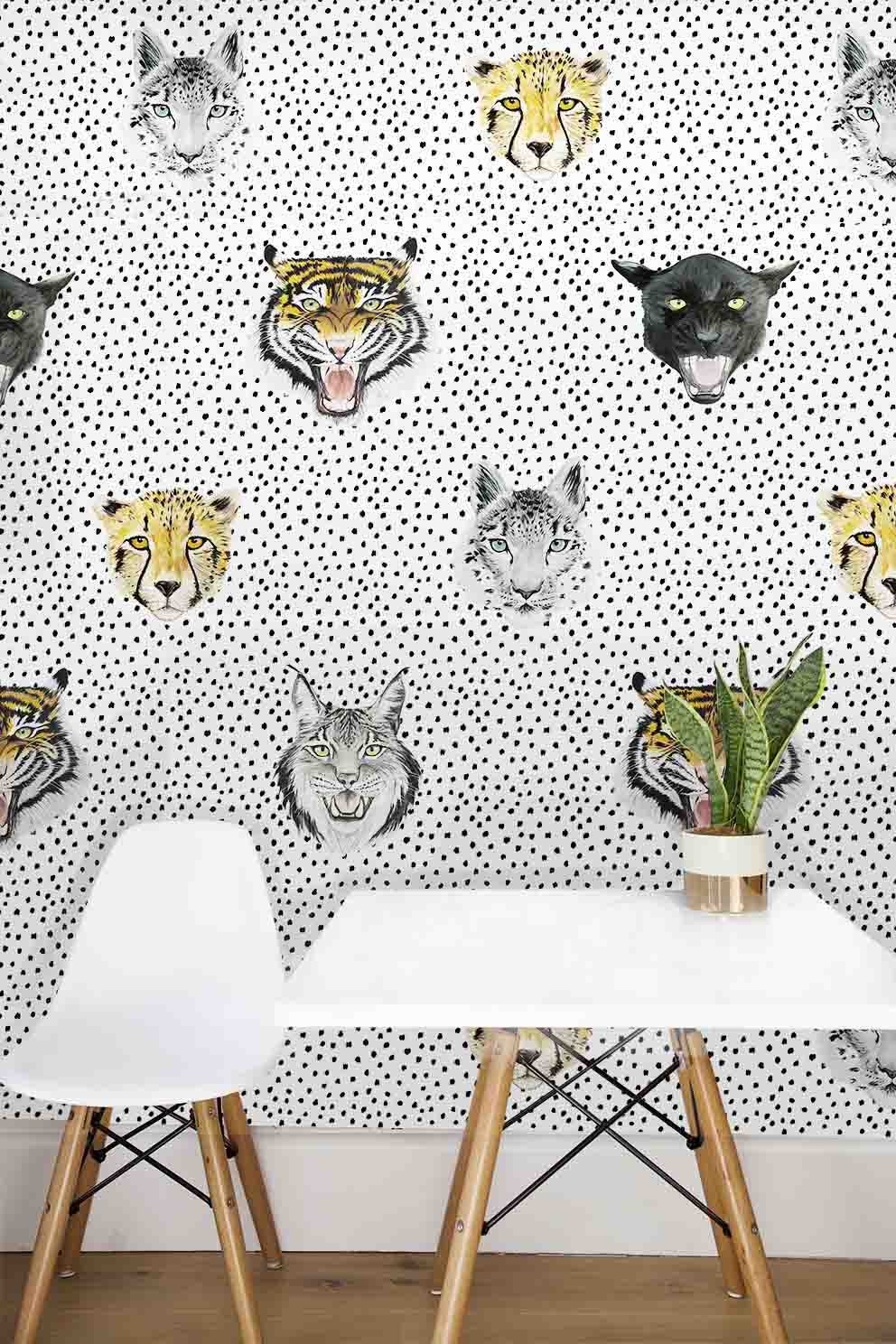 This wallpaper is unisex, it's so cool and modern, tigers, jaguars, and snow leopards are roaring on a monochrome base. Perfect for a kids bedroom or nursery.