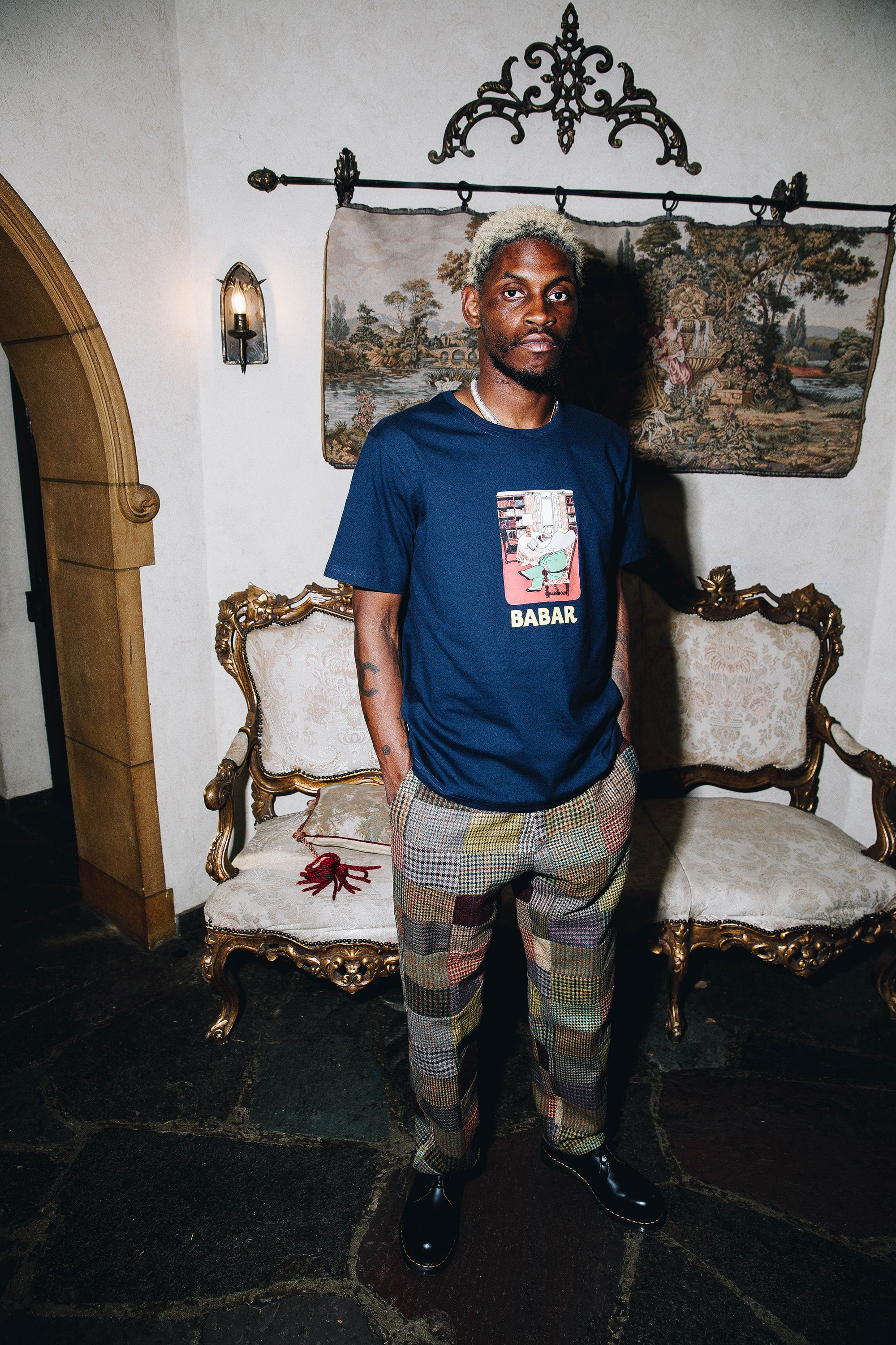 """A$AP Nast wearing the Babar """"Library"""" Tee and the Patchwork Tweed Trousers"""