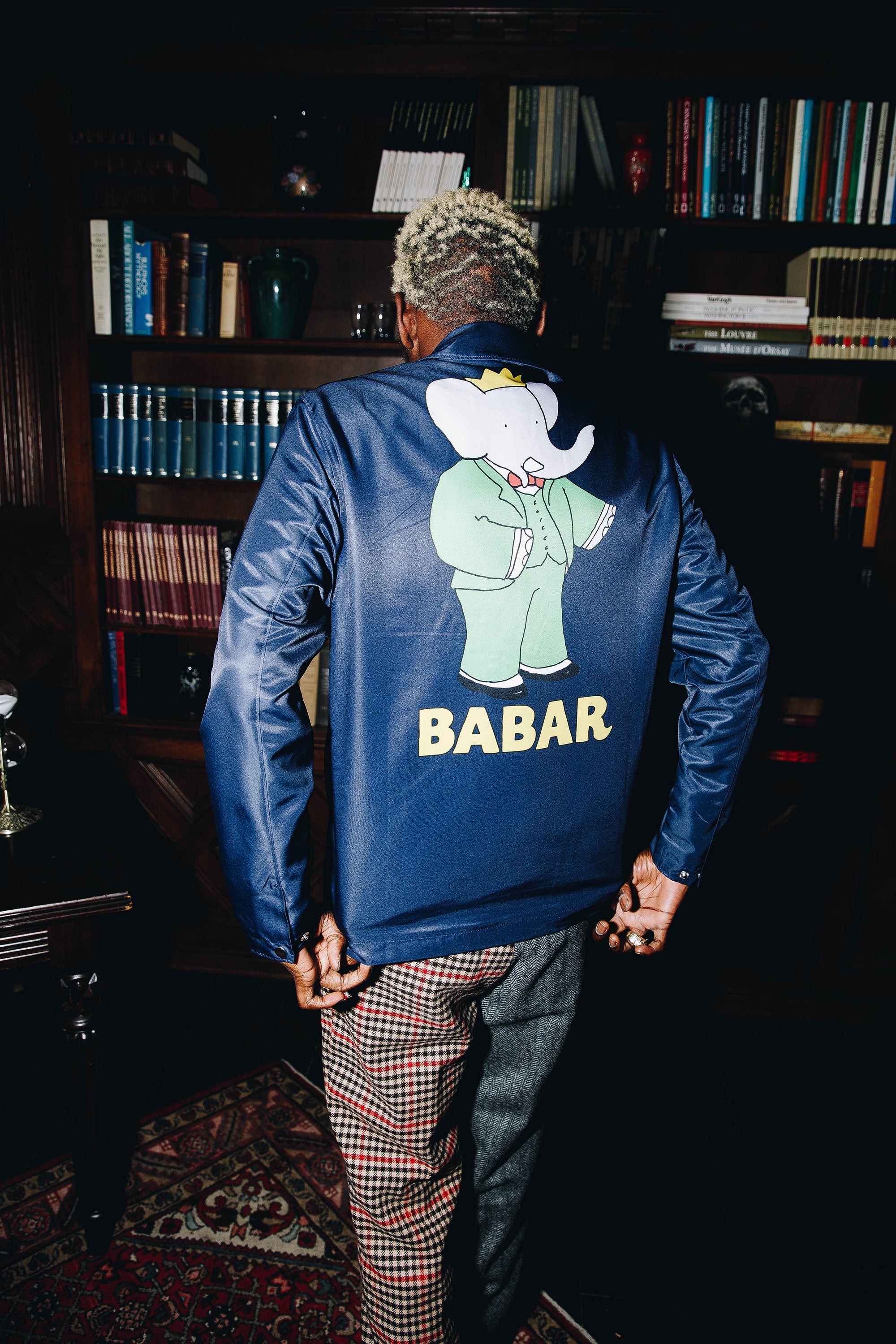 A$AP Nast wearing the Babar Coach's Jacket in blue and the Split Tweed Trousers