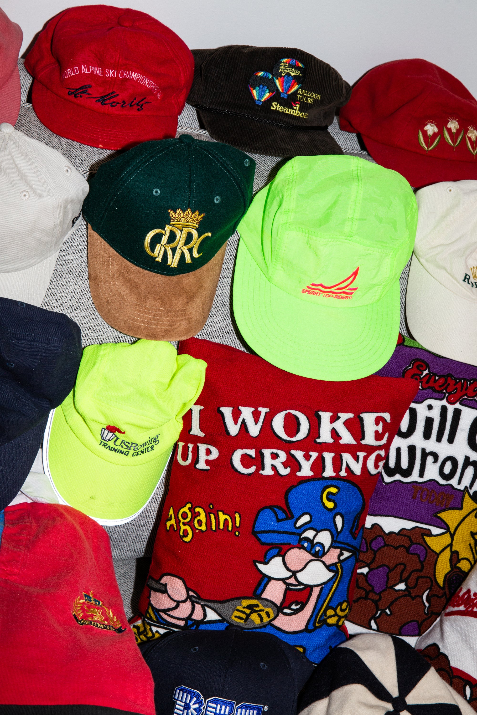 Close-up of different hats and throw pillows