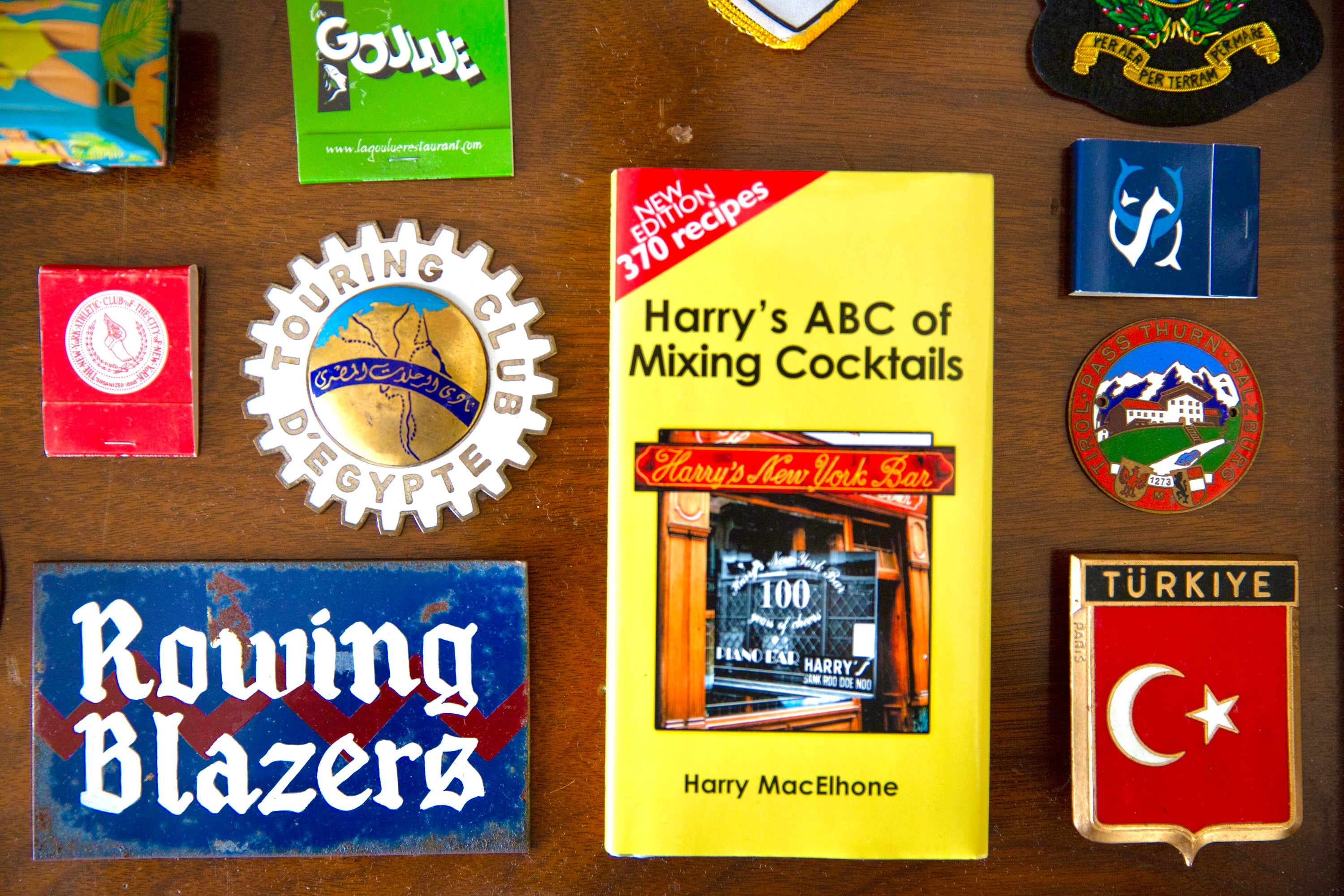 Close-up of various stickers, patches and match books