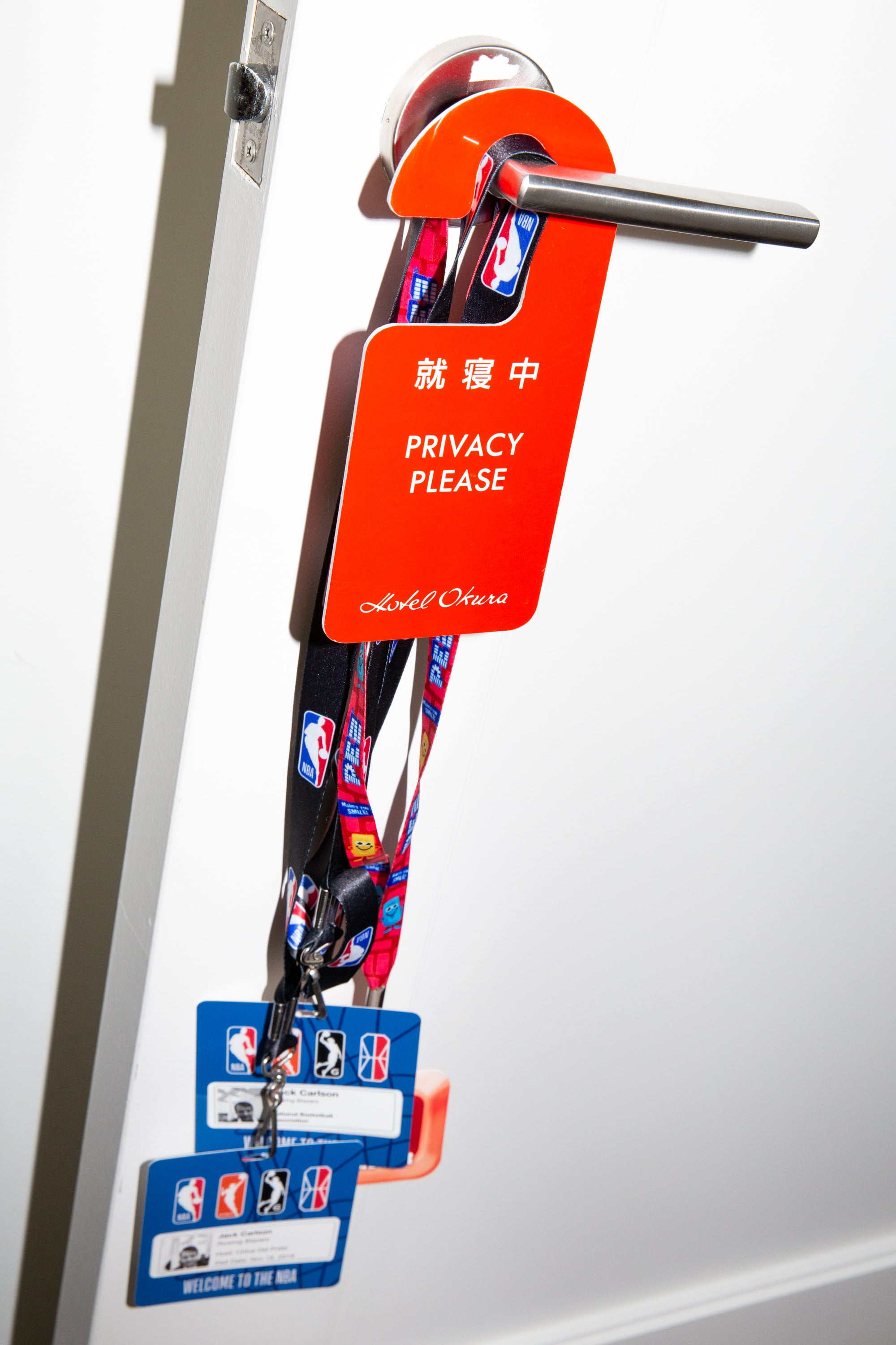 Close-up of various items hanging from a doorknob