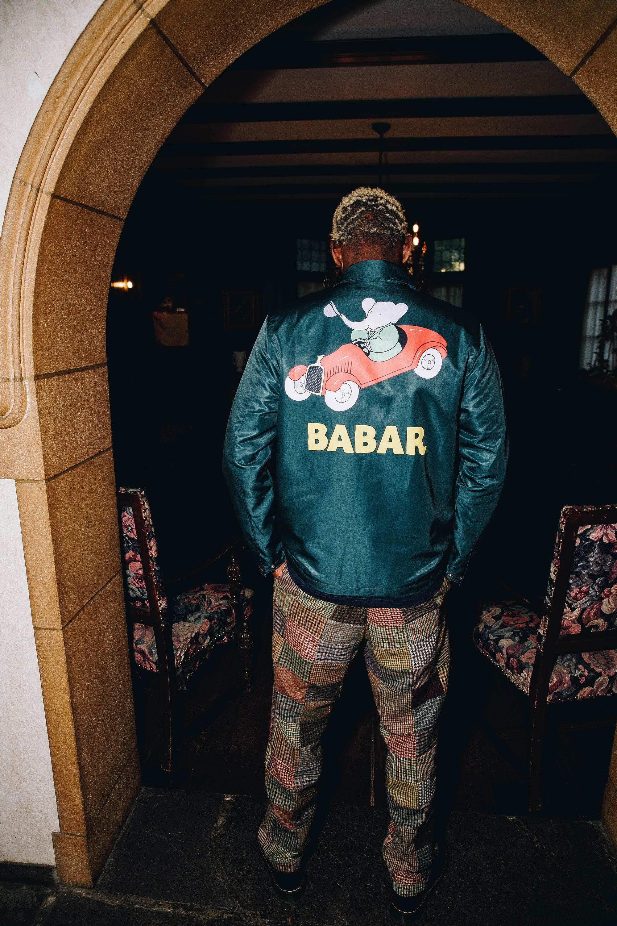 A$AP Nast wearing the Babar Coach''s Jacket in green and the Patchwork Tweed Trousers