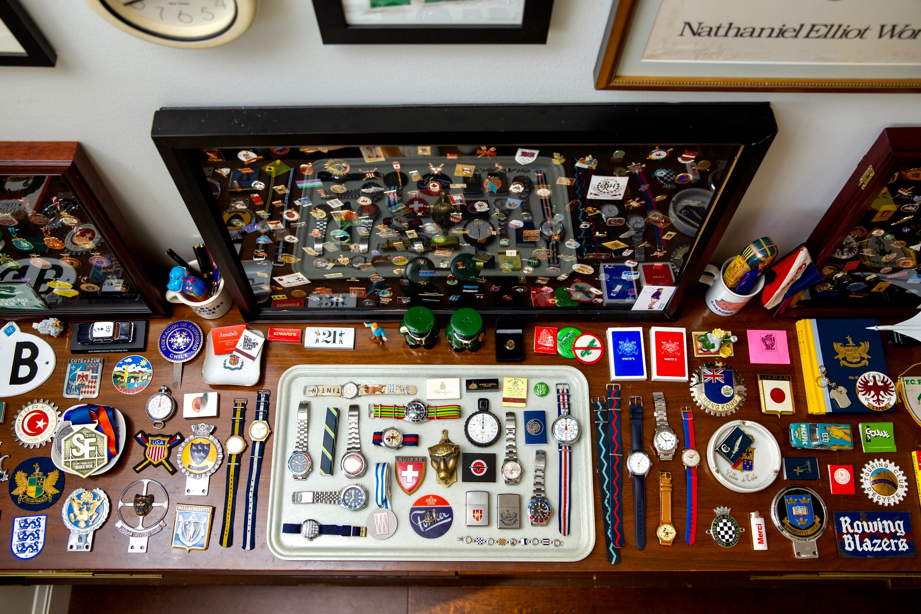Close-up of various pins and watches