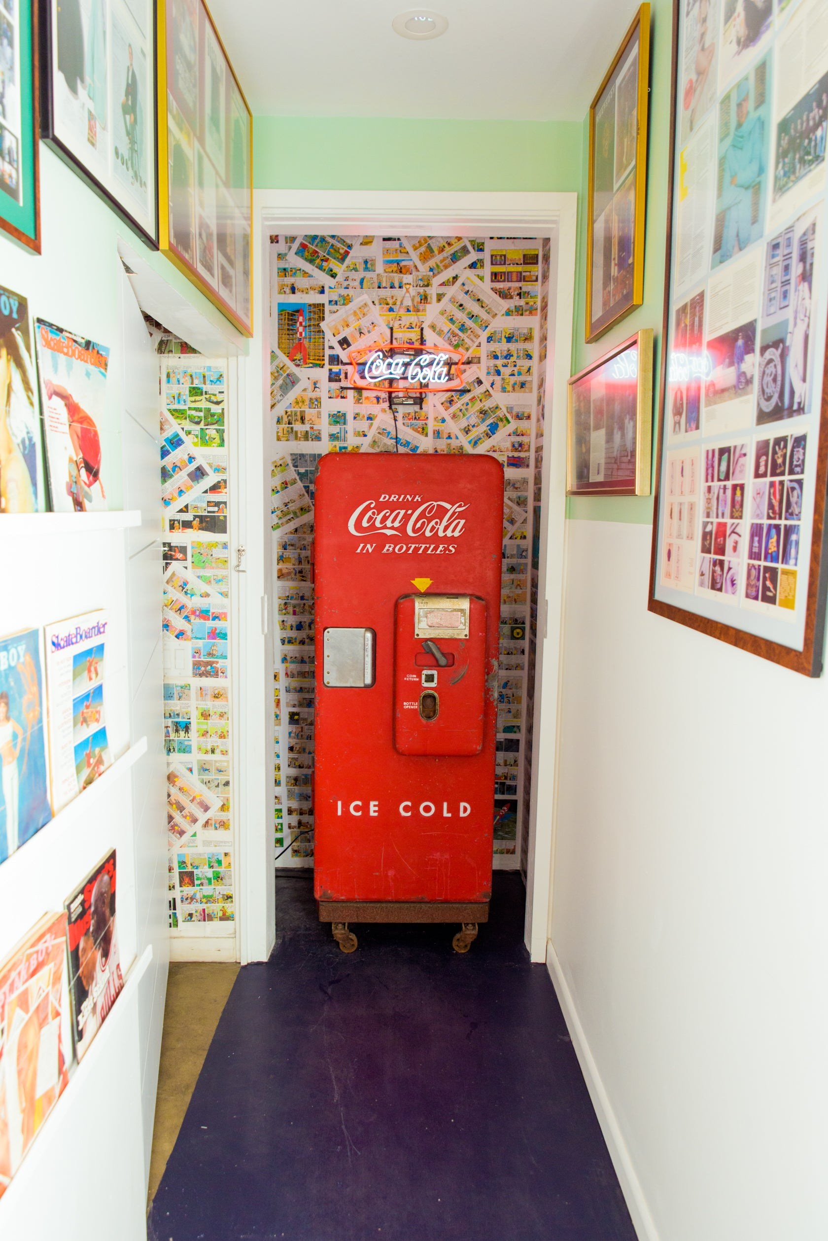 Close-up of an old Coca Cola machine at the Rowing Blazers Store on Grand Street