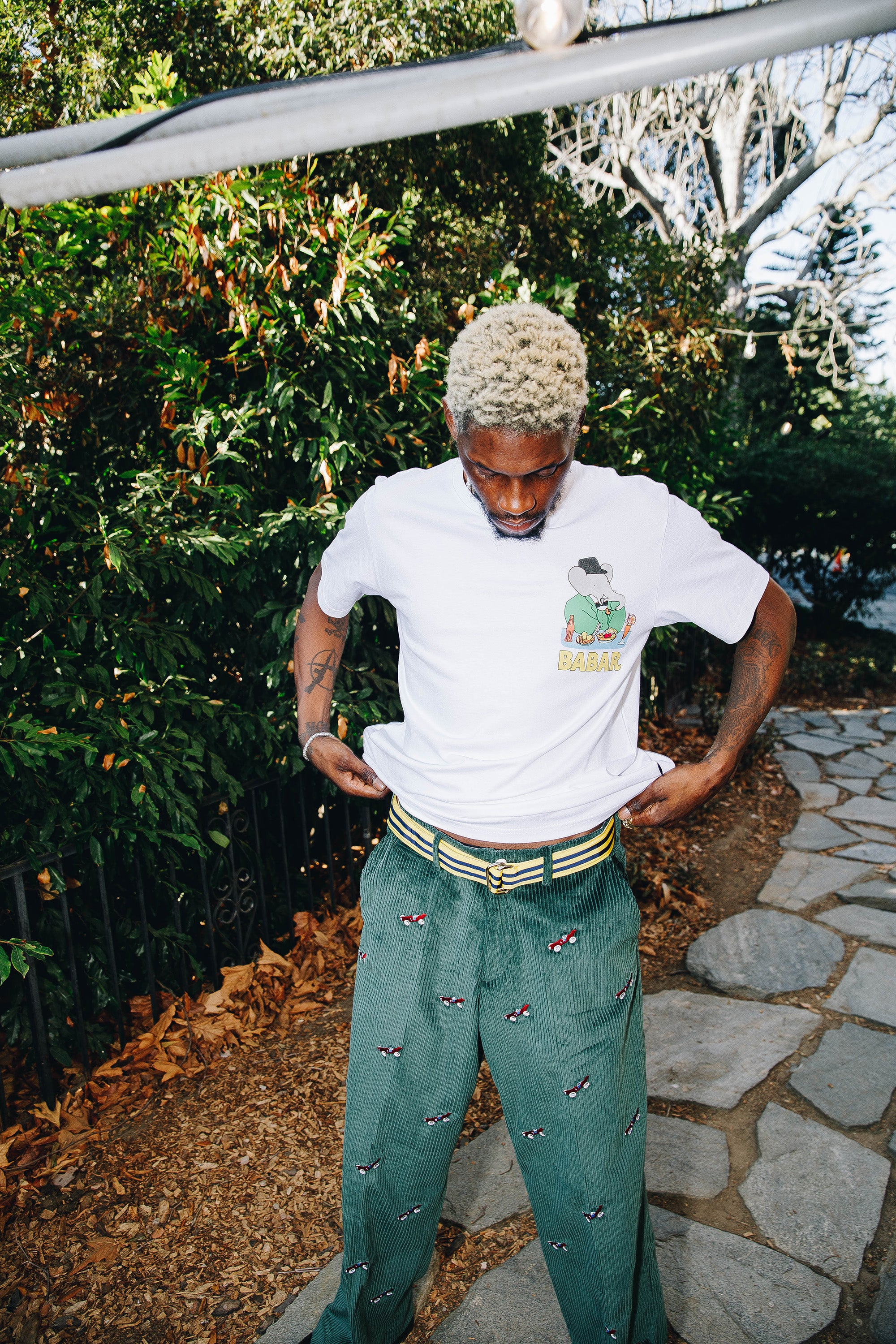 """A$AP Nast wearing the Babar """"Diner"""" Tee and the Babar Corduroy Trousers in green"""