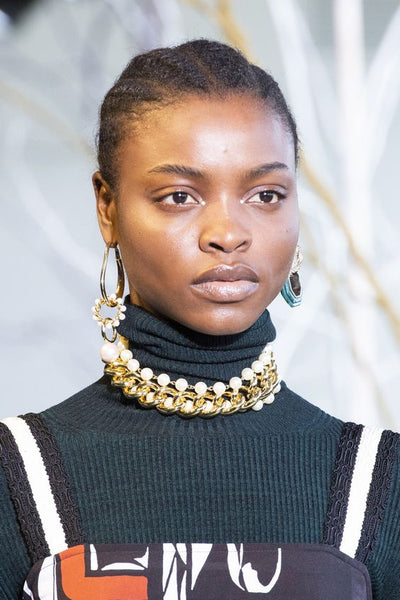 model wearing a pair of choker necklaces