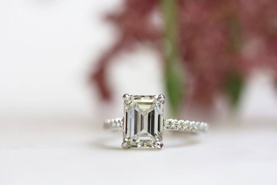 emerald cut diamond ring with moissanite center