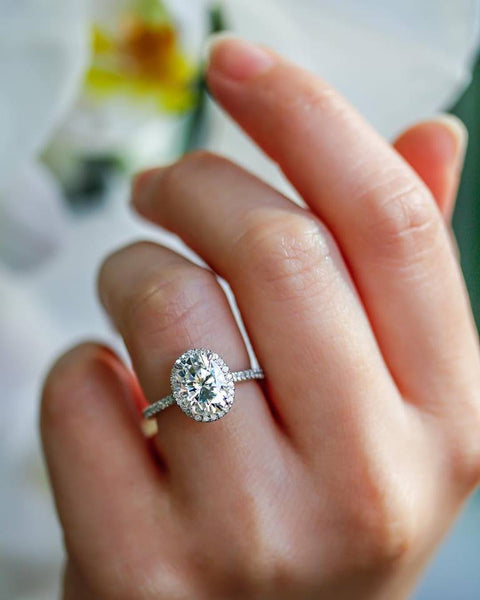 Oval Moissanite and Diamond Halo Engagement Ring in 14K White Gold