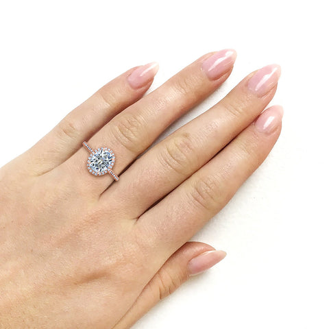 Oval Moissanite and Diamond Halo Engagement Ring in 14K Rose Gold