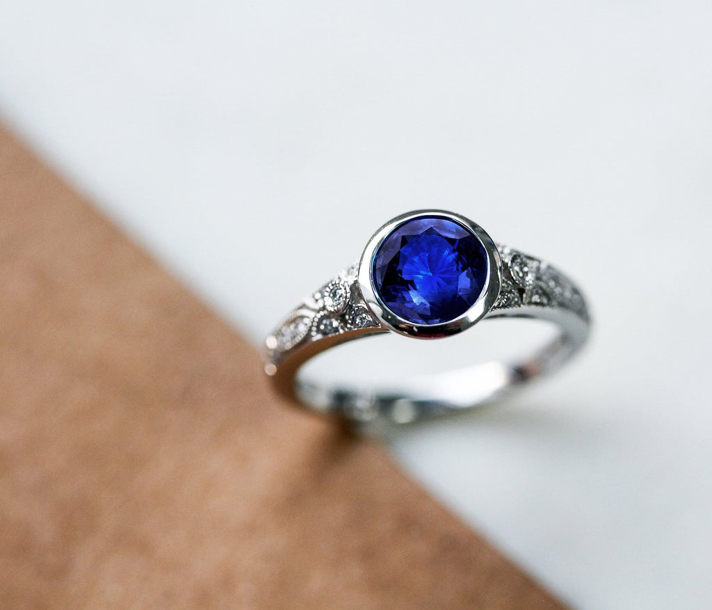 vintage blue sapphire engagement ring with diamond
