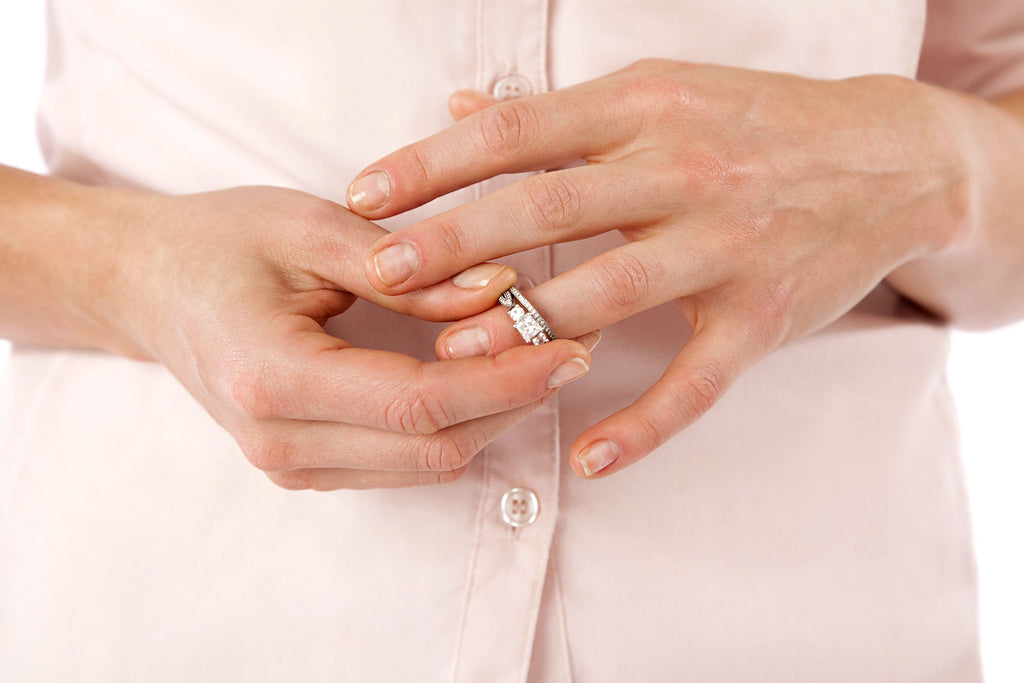 Woman Taking Off Her Bridal Set Ring