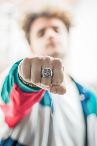 Young Man Posing With Silver Signet Ring