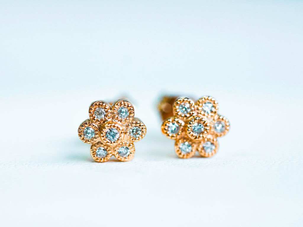 one of a kind earrings with floral design