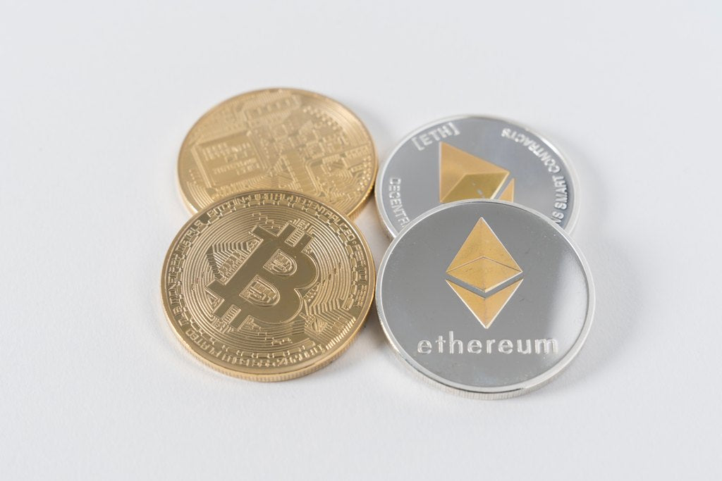 Four Round Silver and Gold Bitcoins