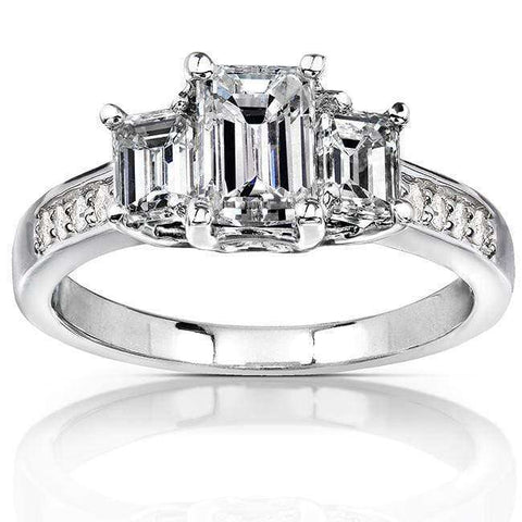3 stone emerald cut diamond ring in white gold