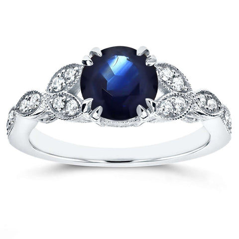 leafy antique sapphire engagement ring in white gold