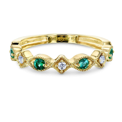 alternating emerald and diamond ring in yellow gold