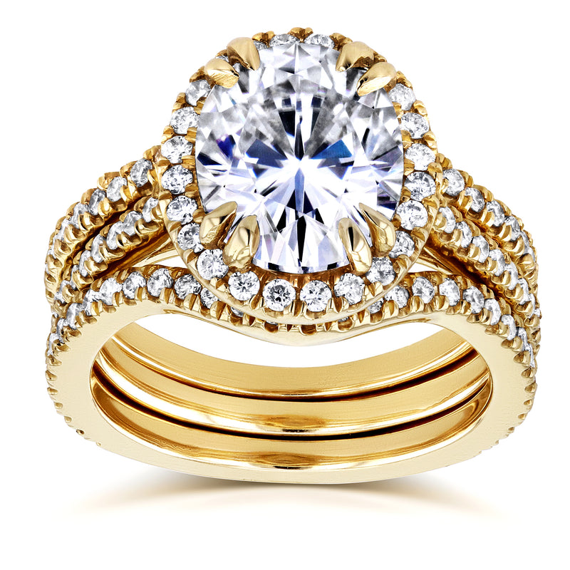 Oval Moissanite and Halo Diamond 3 Piece Bridal Set 3 4/5 CTW in 14k Yellow Gold