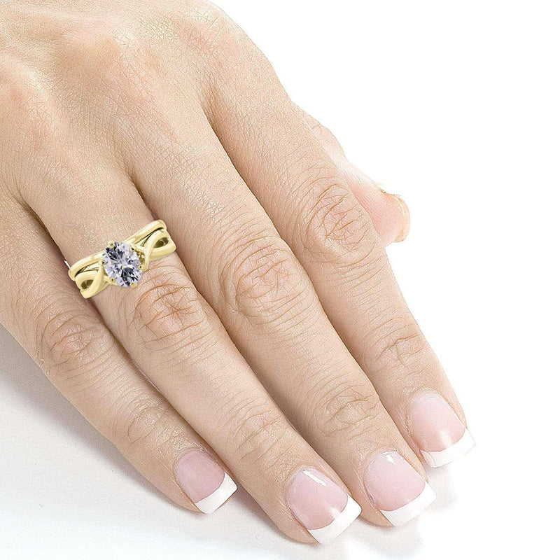Kobelli Forever One DEF Oval Moissanite Solitaire Crossover Bridal Set 1 1/2 CTW 14k Yellow Gold