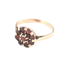 Gold Ring with 9 Set Garnets