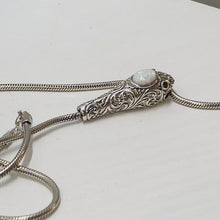 Load and play video in Gallery viewer, Opal Cabochon Sterling Silver Snake Head Necklace.