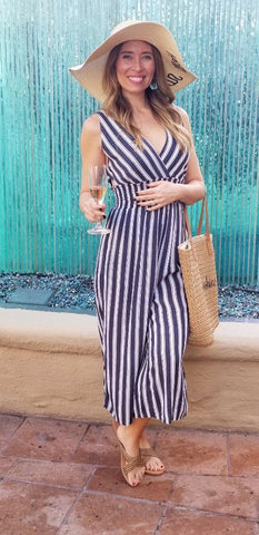 Stripe Jumpsuit for Spring has beautiful cut out details on the sides and back.