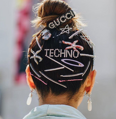 Fall 2019 Hair Trends overload on hair accessories, barrettes, bobby pins, bling clips, gemstones gucci, channel.