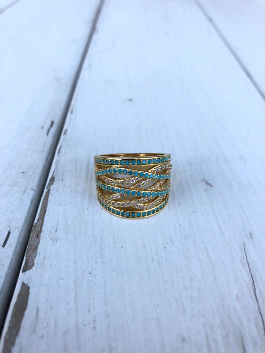 Gold & Blue Rhinestone Swirl Ring  Take your outfit to the next level with OC Social Butterfly's accessory collection. Currently obsessing over our stone rings in gold and silver.  Ships from the USA, unique style, fashion trends, jewelry, bold ring